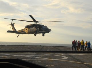 US Army MH-60 from the 160th Special Operations Aviation Regiment taking off from USS Gunston Hall (LSD-44) during a training mission in 2011. US Naval Institute Photo