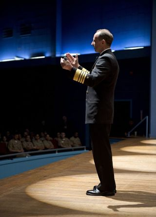 Adm. Jonathan W. Greenert addresses a Sailor's question during an all hands call hosted at Naval Air Station North Island on Jan. 31, 2013.