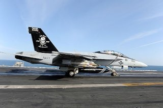 An F/A-18F Super Hornet from the Jolly Rogers of Strike Fighter Squadron (VFA) 103 launches from the flight deck of aircraft carrier USS Dwight D. Eisenhower (CVN-69). U.S. Navy Photo.