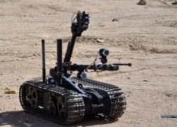 "Man Transportable Robot System ""Talon"" Mark 2 approaches a suspected bomb maker's building during an exercise. US Navy Photo"