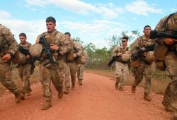 Marines with 1st Platoon, Lima Company, 3rd Battalion, 3rd Marine Regiment, Marine Rotational Force - Darwin, sprint to their first station wearing full gear during a squad competition on May, 23 2013. US Marine Corps Photo