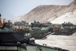 US Marines from Amphibious Assault Vehicle (AAV) Platoon, Battalion Landing Team 3/2, 26th Marine Expeditionary Unit (MEU), drive their AAVs on April 20, 2013. US Marine Corps Photo.