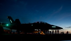 EA-18G Growler from Electronic Attack Squadron (VAQ) 129 to launch during night flight operations aboard the aircraft carrier USS Carl Vinson (CVN-70) in February 2013.