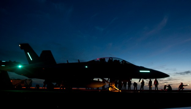 EA-18G Growler from Electronic Attack Squadron (VAQ) 129 during night flight operations aboard the aircraft carrier USS Carl Vinson (CVN-70) in February 2013.
