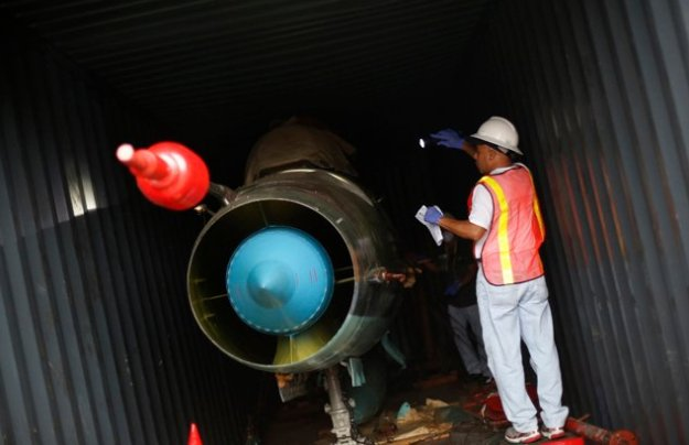 Panamaniain investigators inspect a Cuban MiG 21 found hidden on a North Korean merchant vessel on July 21, 2013. REUTERS Photo