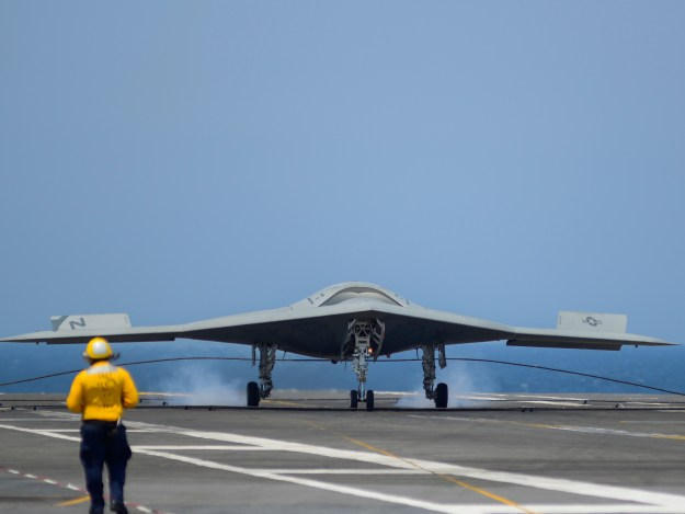 An X-47B Unmanned Combat Air System (UCAS) demonstrator completes an arrested landing on the flight deck of the aircraft carrier USS George H.W. Bush (CVN-77) on July, 10 2013. US Navy Photo