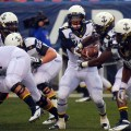 U.S. Naval Academy quarterback Trey Miller (1) hands off the football during the 113th Army-Navy Football game at Lincoln Financial Field in 2012. US Navy Photo