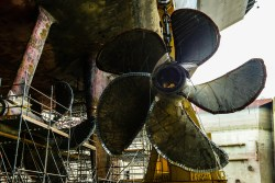 Puget Sound Naval Shipyard removes propeller four from USS John C. Stennis (CVN-74) for maintenance. US Navy Photo