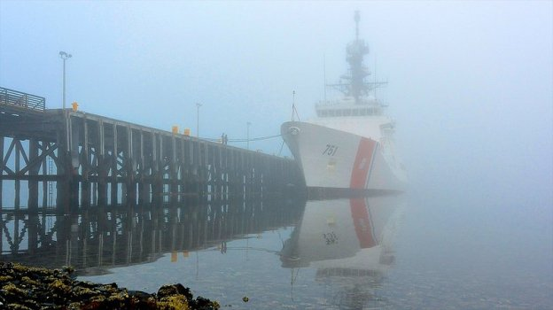 Coast Guard Cutter Waesche is moored to the Coast Guard Base Kodiak fuel pier on a foggy morning in Kodiak, Alaska, on Aug. 19, 2013. US Coast Guard Photo
