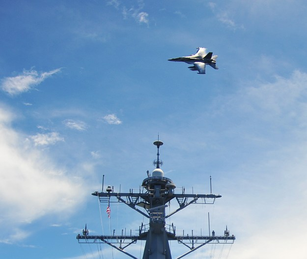 EA-18G Growler assigned to the Electronic Attack Squadron 141 (VAQ) flies over the Arleigh Burke-class guided-missile destroyer USS McCampbell (DDG-85) on Sept. 3, 2012