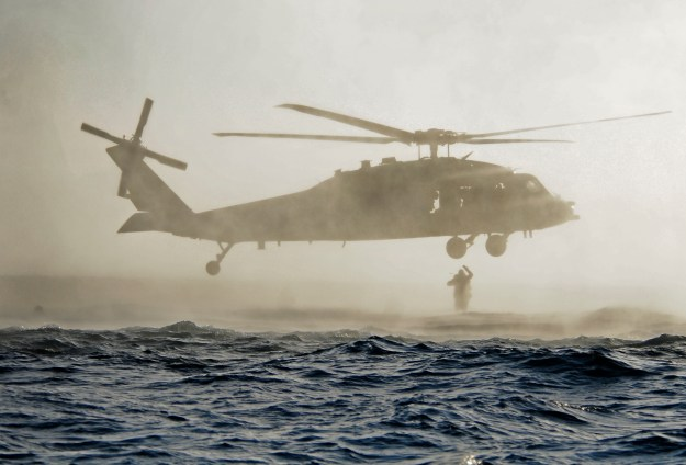 US Navy SEALs jump out of an SH-60 Sea Hawk helicopter during a combat rescue swimmer course. US Navy Photo
