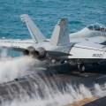 """An EA-18G Growler, assigned to the """"Zappers"""" of Electronic Attack Squadron 130, launches from the flight deck of the aircraft carrier USS Harry S. Truman (CVN-75) on Jan 13, 2014. US Navy Photo"""