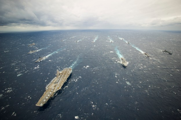 USS George Washington (CVN-73) and its strike group in 2013. The House voted to refuel the carrier rather than decommission the ship. US Navy Photo