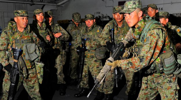 Japan Ground Self-Defense Force conduct small arms weapons training aboard the amphibious assault ship USS Peleliu (LHA-5) in 2012. US Navy Photo