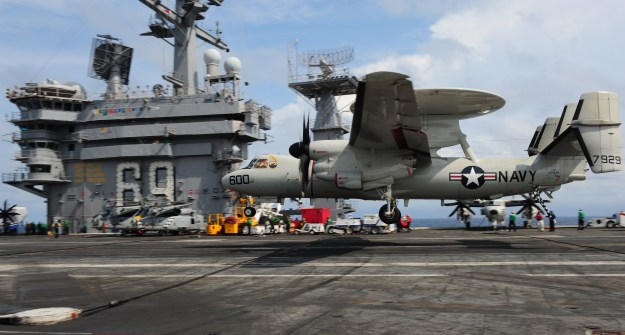 An E-2D lands on the aircraft carrier USS Dwight D. Eisenhower (CVN-69). US Navy Photo