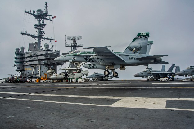 F/A-18E lands on aircraft carrier USS George Washington (CVN-73). US Navy Photo