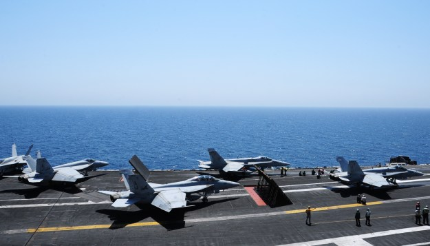 Sailors launch aircraft from the flight deck of the aircraft carrier USS George H.W. Bush (CVN 77) on Aug. 7, 2014. US Navy Photo