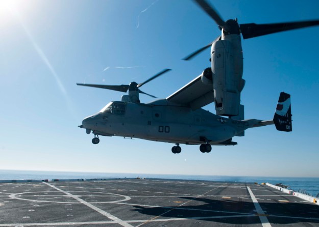 An MV-22 Osprey tilt rotor aircraft from Marine Medium Tilt Rotor Squadron (VMM) 163 lands aboard the San Antonio-class amphibious transport dock ship USS San Diego in 2013. US Navy Photo