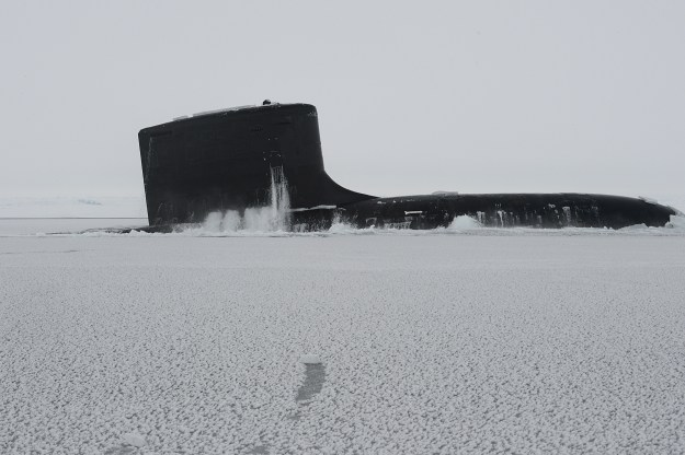 USS New Mexico (SSN 779) surfaces through the arctic ice during Ice Exercise (ICEX) 2014. US Navy Photo