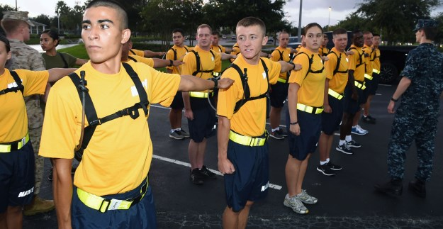 Naval ROTC incoming midshipmen freshmen perform a facing movement during NROTC freshman orientation at Embry-Riddle Aeronautical University on Aug. 15, 2014. US Navy Photo