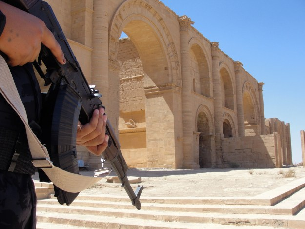 A soldier stands guard near the remains of Hatra, Iraq on June 22, 2013. Photo via Xinhua/ZUMAPRESS