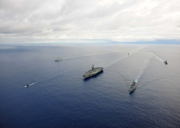 USS Theodore Roosevelt (CVN 71) leads ships from Carrier Strike Group (CSG) 12 during a maneuvering exercise on Sept. 23, 2014. US Navy Photo