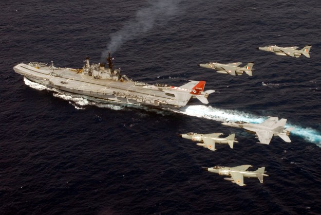 fly in formation with two Indian Navy Sea Harriers, bottom, and two Indian Air Force Jaguars, right