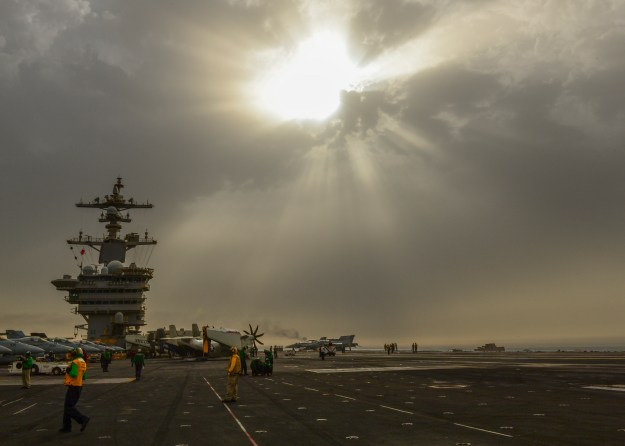 Sailors aboard the aircraft carrier USS Carl Vinson (CVN-70) prepare the flight deck for flight operations. US Navy Photo