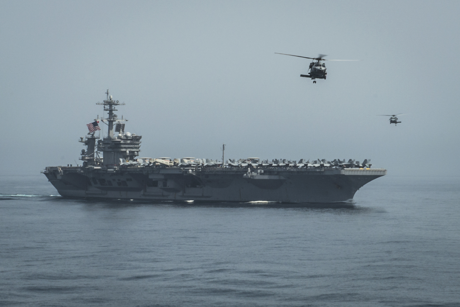 Helicopters fly from the aircraft carrier USS Theodore Roosevelt (CVN-71) on April 13, 2015. US Navy Photo