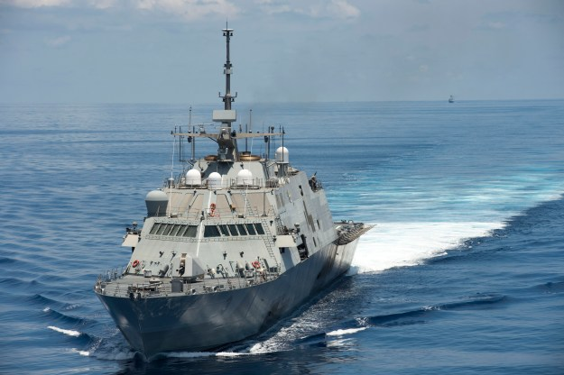 The littoral combat ship USS Fort Worth (LCS 3) conducts patrols in international waters of the South China Sea near the Spratly Islands as the People's Liberation Army-Navy [PLA(N)] guided-missile frigate Yancheng (FFG 546) transits close behind on May 11, 2015. US Navy photo.