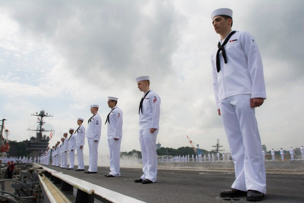 Sailors stand in formation as the USS George Washington (CVN-73) departs for its 2015 patrol. US Navy Photo