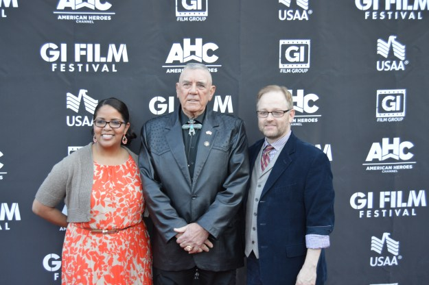 Actor and Marine R. Lee Ermey, center, stands with GI Film Festival organizers Laura Law-Millett and Brandon Millett on Saturday, May 23, 2015. USNI News photo.