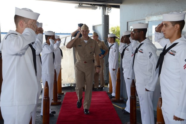 Then-Rear Admiral James Caldwell, Commander, Submarine Force U.S. Pacific Fleet, arrives on board submarine tender USS Emory S. Land (AS 39) on July 25, 2013. US Navy photo.