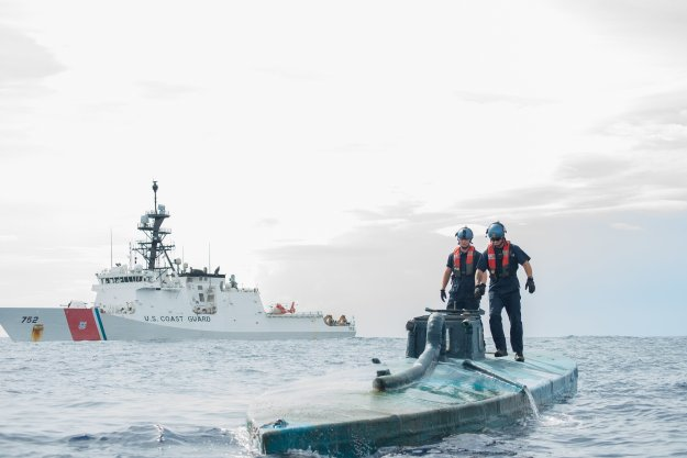A Coast Guard Cutter Stratton boarding team investigates a self-propelled semi-submersible interdicted in international waters off the coast of Central America on July 19, 2015. US Coast Guard Photo