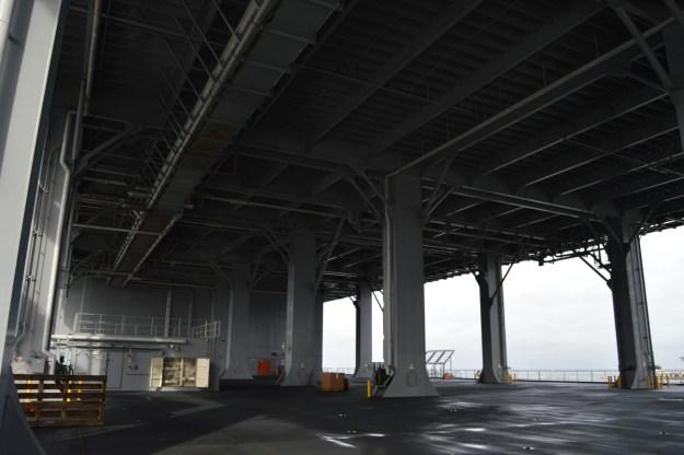 Under Puller's flight deck. USNI News Photo