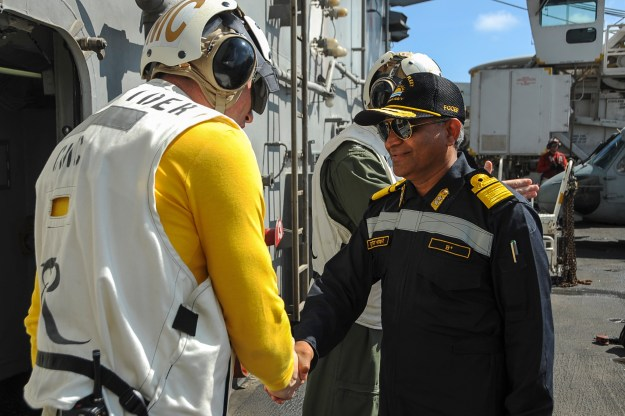 Command master chief of the aircraft carrier USS Theodore Roosevelt (CVN-71), greets Rear Adm. SV Bhokare, Flag Officer Commanding Eastern Fleet, Indian Navy as part of Exercise Malabar 2015. US Navy Photo