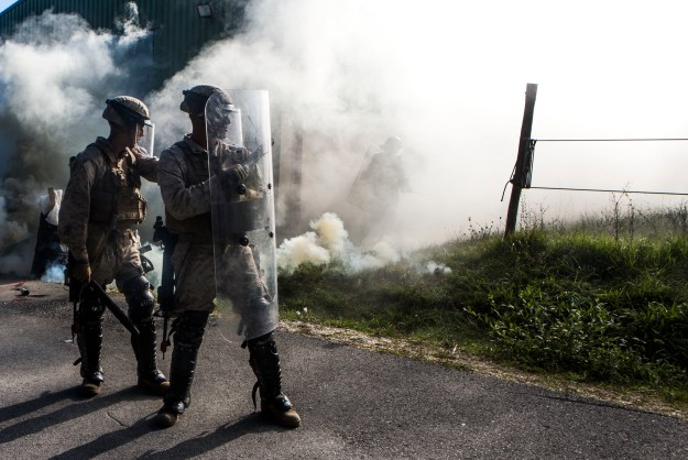 U.S. Marines stand guard during a simulated civilian evacuation at the National Gendarmerie Tactical Training Center in Saint-Astier, France, Oct. 9, 2015. The exercise marks the third rotation of Special-Purpose Marine Air-Ground Task Force Crisis Response-Africa Marines training alongside the Gendarmerie. US Marine Corps photo.