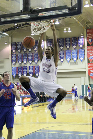 FRESHMAN FORWARD MALIK LONDON jams home 2 points during the Grizzlies' game Tuesday night, Jan. 8, against Volunteer State Community College (Missouri State-West Plains Photo/Mat Crouse)