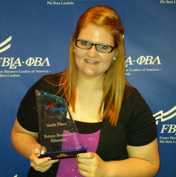 TORI PORTER, a freshman from Williamsville, Mo., placed sixth in the future business educator competition at the 2014 Future Business Leaders of America-Phi Beta Lambda (FBLA-PBL) National Leadership Conference June 24-27 in Nashville, Tenn.  The preliminary round of the competition consisted of an interview based on the student's application, resumé and letter of reference for a teaching position.  In the final round, Porter presented a classroom plan that was prepared in advance.  The award was part of a comprehensive national competitive events program sponsored by FBLA-PBL that recognizes and rewards excellence in a broad range of business and career-related fields.  In addition to the competition, Porter took part in a variety of educational workshops, visited an information-packed exhibit hall and attended motivational presentations on a broad range of business topics.  More than 1,800 college students from across the country participated in the conference.  (Photo provided)
