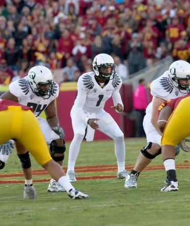 Oregon (playing against USC last year at the Los Angeles Coliseum) will begin the new season under a cloud./Photo Credit: Mac Alexander