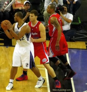 Blake Griffin and Caron Butler apply stiff defense on Chuck Hayes of the Sacramento Kings. Photo: Dennis J. Freeman