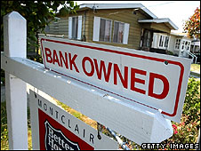 For sale sign on a bank owned house