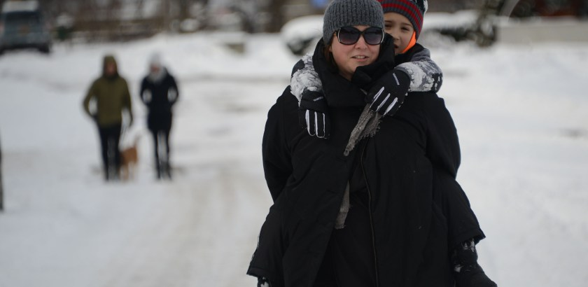 Pam Panchak/Post-Gazette  01232016  PHOTOSLUG: SnowWalk  SECTION: LOCAL  CAPTION: Heather Mallak (cq) from Lawrenceville carries her son, Zeev (cq), 6, the final way home after a morning of walking along the Riverfront Trail in Lawrenceville Saturday, January 23, 2016  WRITER: Standalone   STORYSLUG:  none  (PLS NOTE: Her family is featured in the mag  (soon?)for a house on shipping container homes.)