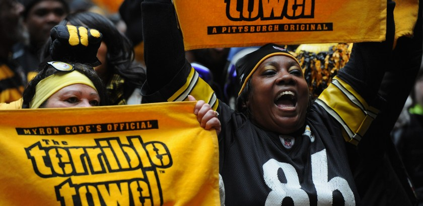 Rebecca Droke/Post-Gazette-- Friday, January 8 , 2016-- Sisters Deneen Springs, left,  of East Liberty and Leslie Springs of Wilkinsburg get pumped during the Steelers Playoff Rally at the Courthouse Courtyard Downtown on Friday, January 8, 2016.