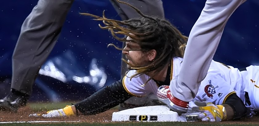 Peter Diana / Post-Gazette 04062016  PITTSBURGH Sports:  Pittsburgh Pirates John Jaso slides safely in to third and then scores on the overthrow against the Cardinals at PNC Park PIttsburgh PA