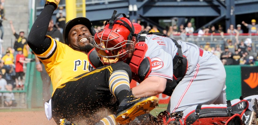 Matt Freed/Post-Gazette Pirates' Andrew McCutchen scores against Reds' Tucker Barnhart in the eighth inning Sunday afternoon at PNC Park.
