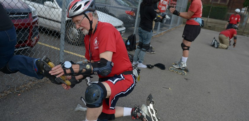 Pam Panchak/Post-Gazette  06152016  PHOTOSLUG: SkatePittsburgh SECTION: LOC A2 CAPTION: Gene Slevinski (cq), head of the National Skate Patrol (NSP) Pittsburgh Chapter, works on oiling a beginning skaters skates during a Three Rivers Inline Club / NSP Start & Stop Clinic at the Liberty Elementary playground in Shadyside. WRITER:  STORY SLUG: