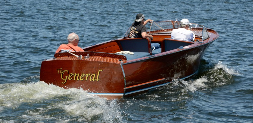 """Darrell Sapp/Post-Gazette /Conneaut Lake, Pa. — for Sunday Bulldog Edition— STAND ALONE—         GETTING LAUNCHED FOR THE BOAT SHOW— Bob Moss , of Conneaut Lake, pilots """"The General"""", a 1950 22 ft long utility Chris Craft.   Bob's fauther bought the boat new in 1950. It is part of the 20th Annual Conneaut Lake Classic Boat Show, at the Ice House Park  on the June 18th & 19th.  It's sponsored by the Allegheny Chapter of the Antique & Classic Boat Society.   digital image #dsc2910           slug — 20160617dsConneautBoatShow4SunBulldog01.jpg"""