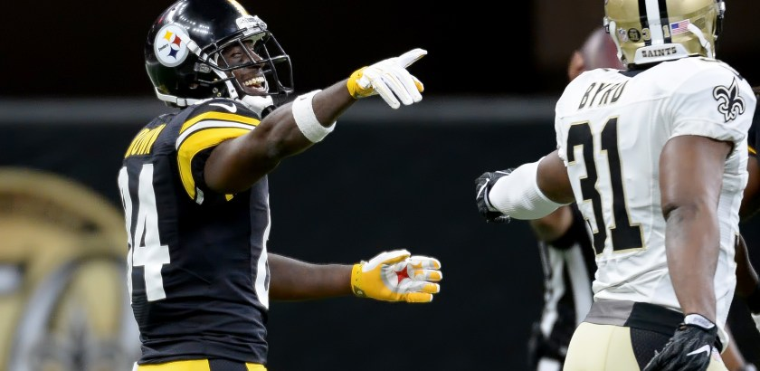Matt Freed/Post-Gazette Steelers' Antonio Brown jokes with Saints' Jairus Byrd after a carry in the first quarter Friday at the Mercedes-Benz Superdome in New Orleans.