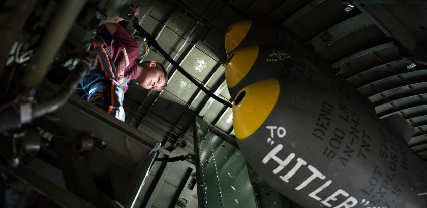 Codi Goehring, 8, from Butler, explores the inside of the WWII aircraft, the B-17 Flying Fortress, at the Butler County Airport for the Collings Foundation's Wings of Freedom Tour in Butler on August 15, 2016. (Haley Nelson/Post-Gazette)